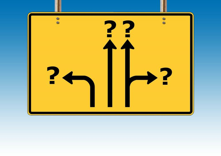 Billboard with question marks in different directions